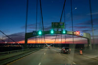 driving over a bridge early morning at sunriseac