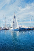 Yachts and boats in the harbor on Mediterranean sea coast, travel and leisure