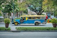 Manila, Philippines - Feb 02, 2020: Jeepneys on the roads of Manila. Former American military jeeps converted to public transport.