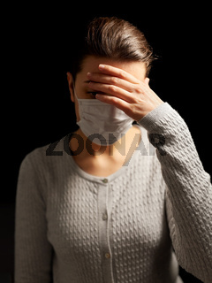sick young woman in protective medical face mask