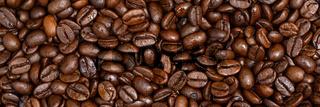 Full frame shot of roasted coffee beans for the banner.