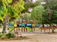 Multicoloured playground in tropical park, Spain