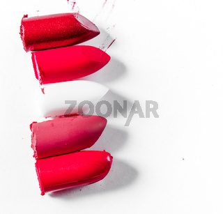 Cutted lipstick close-up isolated on white background