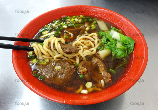 Braised beef in broth with noodles and chives is a popular dish in Taiwan