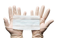 Human hands holding surgery medical face mask in white gloves isolated on white background