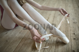 putting on ballet shoes