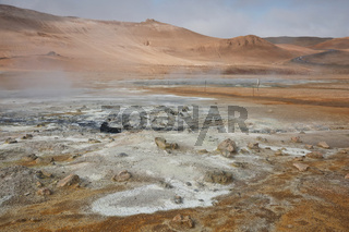 Námaskarð. Fumarole field in Namafjall, Iceland. Namaskard geothermal beauty landscape with mud pools and steam. Icelandic brown landscape. Landscape which pools of boiling mud and hot springs