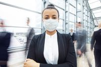 Business woman wearing protective mask