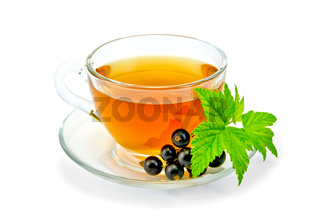 Tea with black currants in a cup