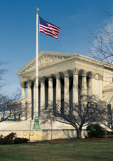 Supreme Court in Washington DC with the US flag flying in front of the building