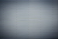 Corrugated metal sheet. New and Modern silver grey background pattern with nice vignetting.