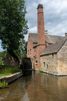 Traditional English Watermill by small stream