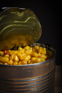 Tin with canned sweet corn.