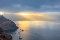 Rays of the Sun Through Heavy Clouds Over the Caldera of Santorini
