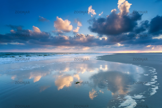 cloudscape reflected in North sea waves