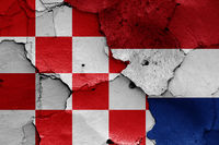 flags of North Brabant and Netherlands painted on cracked wall