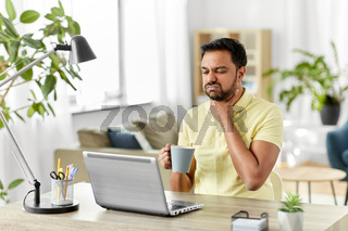 sick indian man with sore throat working at home