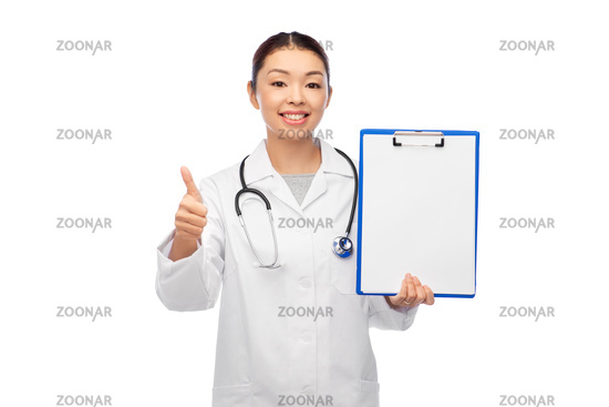 asian female doctor with clipboard shows thumbs up