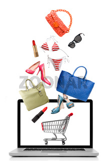 Things to buy falling into notebook isolated on white. Shopping concept