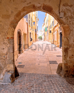 Saint Tropez historic town gate and colorful street view