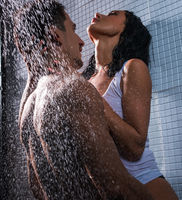 Attractive couple in passionate embrace in shower