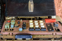 Old, dirty and damaged mechanical calculating machine