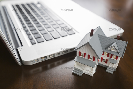 Miniature House And Laptop Computer