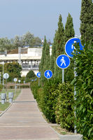 Pedestrian road with many signs