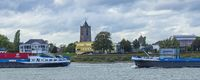 Skyline city Tiel with cargo ships