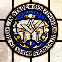 Seal of the guild of carpentry from 1663 as a stained glass window, town hall, Stade, Germany