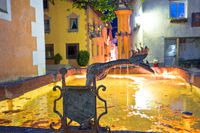 Town of Kastelruth or Castelrotto fountain and street evening view