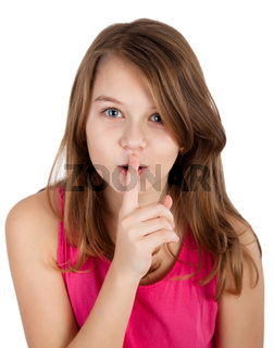 young girl with finger on her lips