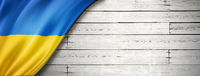 Ukrainian flag on old white wall banner