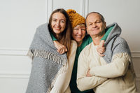 Nice portrait of family with elderly mature woman, man and millennial daughter