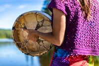 A woman's ritual lakeside dance