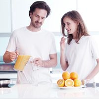 Couple with orange juice
