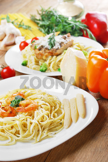 Pasta with shrimps and sauce on the wooden table