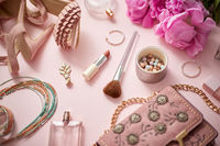 Beauty and fashion accessories and gadgets. Femine concept. Flat lay on pink theme background