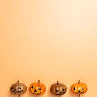 Halloween concept. Pumpkins on orange background. top view, copy space