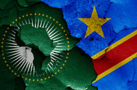 flags of African Union and DR Congo painted on cracked wall