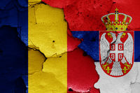 flags of Romania and Serbia painted on cracked wall