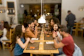 Blurred image of friends at the restaurant