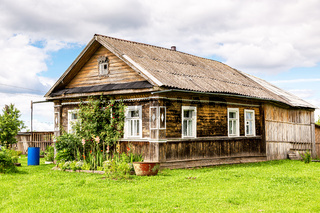Typical rural wooden house in russian village