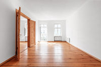 empty room in renovated  flat  with wooden  floor and balcony