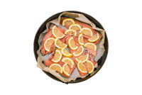 Slices of red fish with lemon lie in a baking sheet. Raw chopped salmon. Preparing to cook fish in the oven.