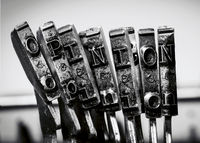 the word  OPINION with old typwriter keys