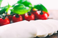 Cutted mozzarella cheese with cherry tomatoes