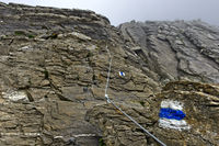 blue and white marked alpine hiking trail, Grindelwald, Bernese Oberland, Switzerland