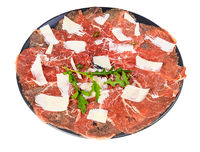portion of Carpaccio dish on black plate isolated