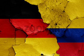 flags of Germany and Colombia painted on cracked wall